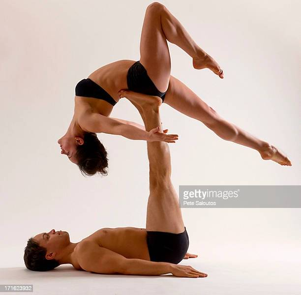 Mid adult couple performing modern dance