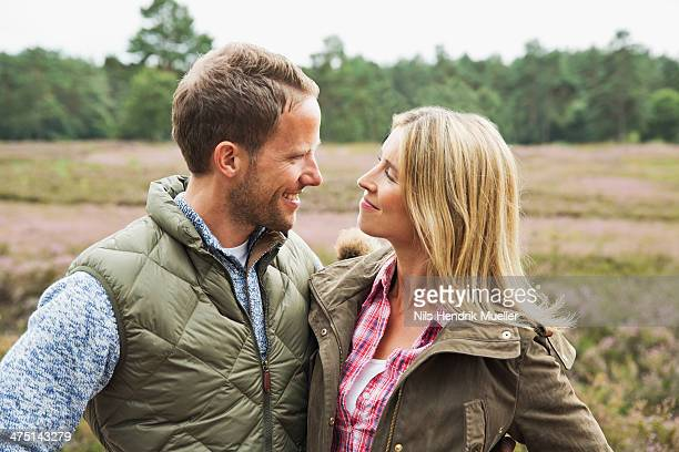 Mid adult couple smiling face to face