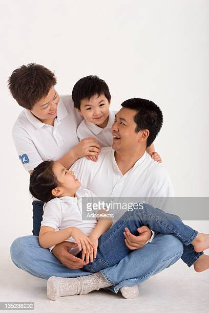 Mid adult couple smiling with their children
