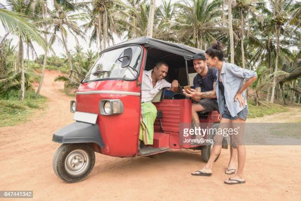 Mid adult couple talking to rickshaw driver, Sri Lanka