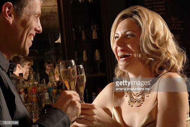 Mid adult couple toasting with champagne