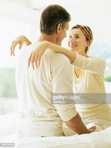 mid adult couple with arms around