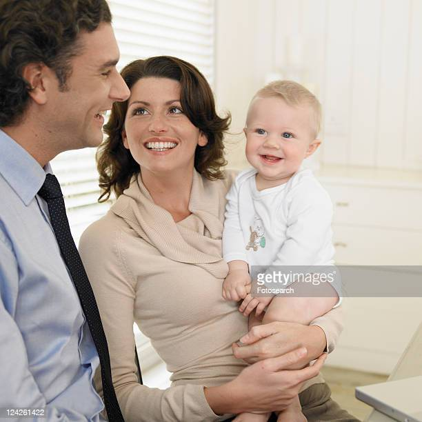 Mid adult couple with baby boy (0-6 months)