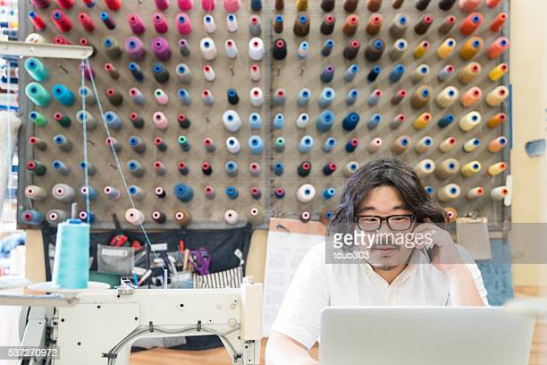 Mid adult fashion designer working in his studio
