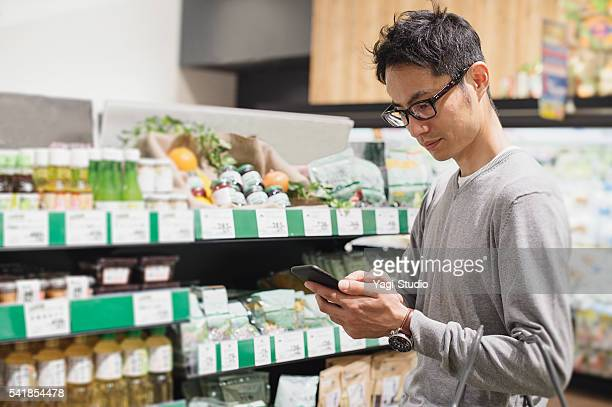 Mid adult male buying grocery in supermarket