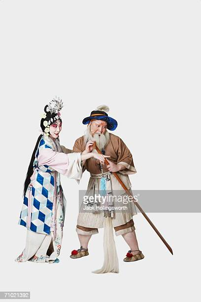 Mid adult man and a mature woman wearing traditional clothing