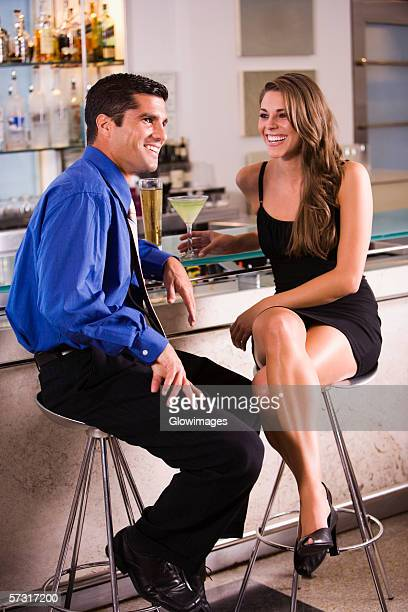Mid adult man and a young woman sitting in a bar