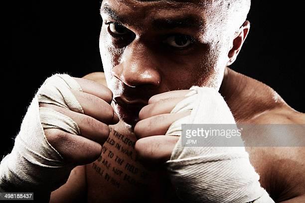 Mid adult man boxing, close up