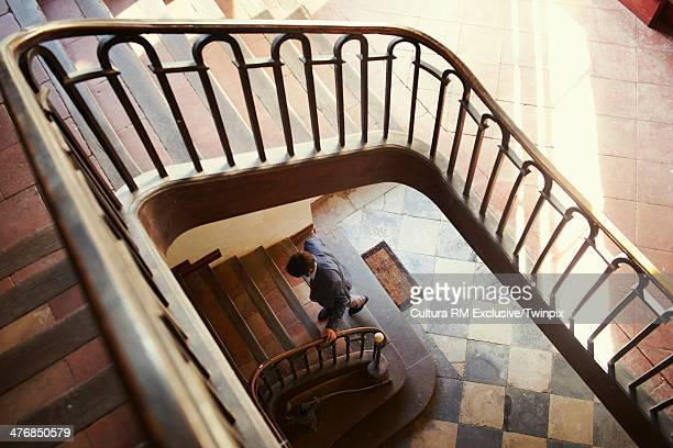 Mid adult man climbing lobby stairs
