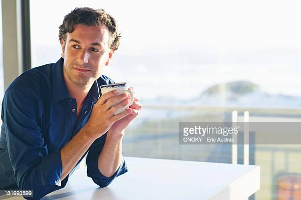 Mid adult man drinking coffee