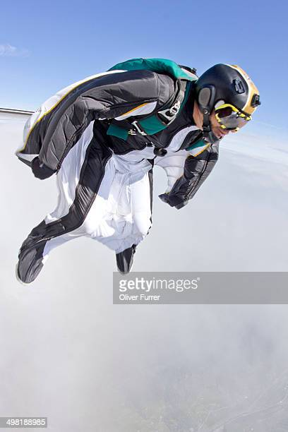 Mid adult man free falling in wingsuit preparing to fly