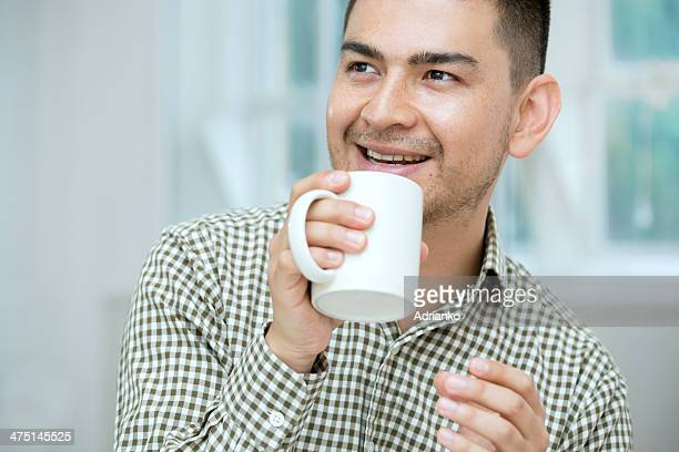 Mid adult man having coffee