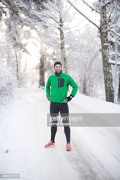 Mid adult man in sports clothes at winter