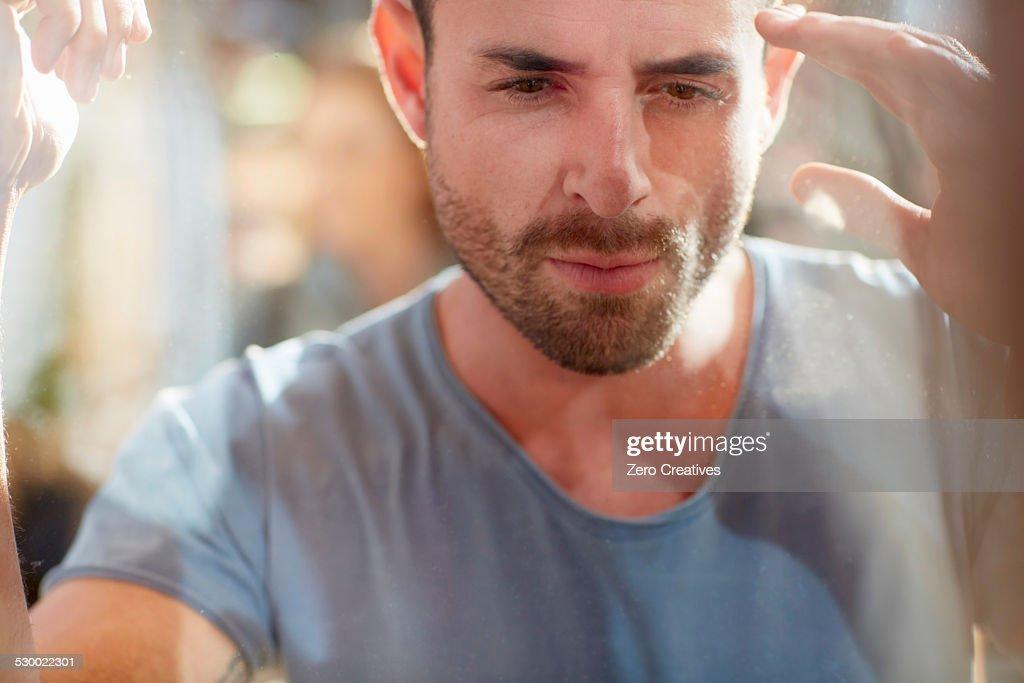 Mid adult man looking in shop window