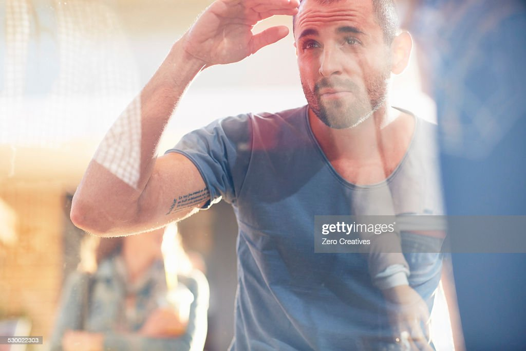 Mid adult man looking in shop window