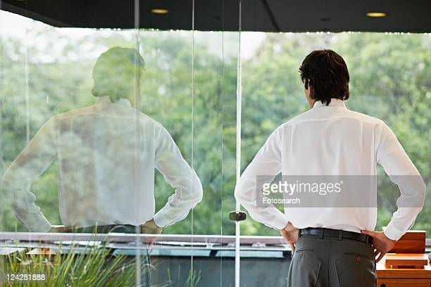 Mid Adult Man Looking Through Window