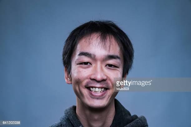 Mid adult man looking very happy or satisfied