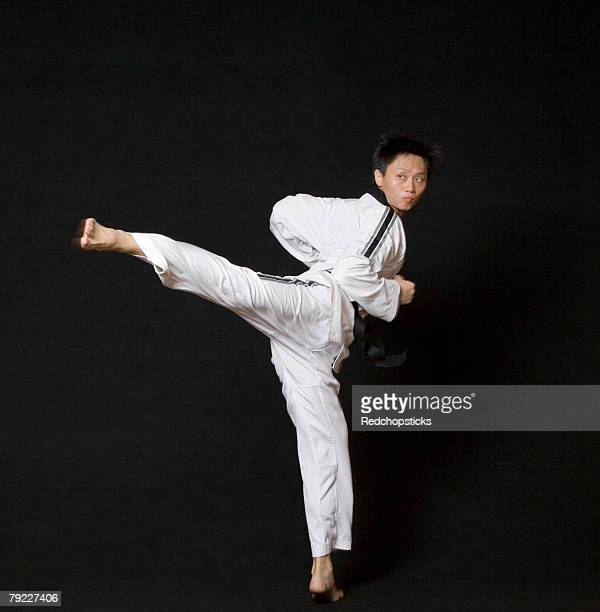 Mid adult man performing the side kick