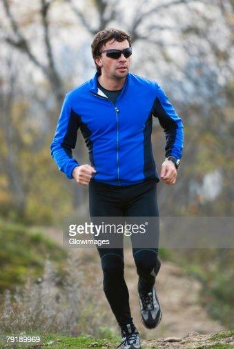 Mid adult man running : Foto de stock