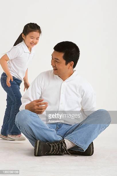 Mid adult man sitting on the floor
