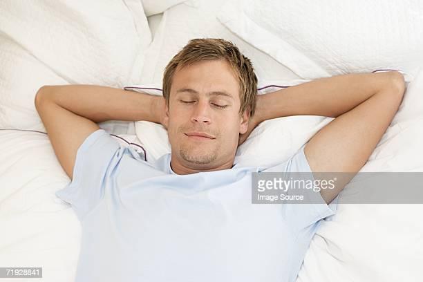Mid adult man sleeping