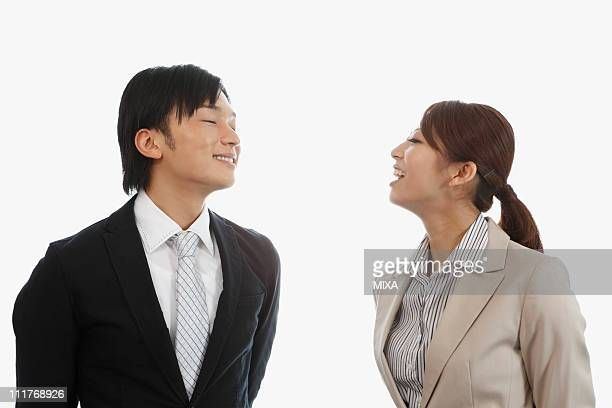 Mid Adult Man Smelling Young Woman's Breath