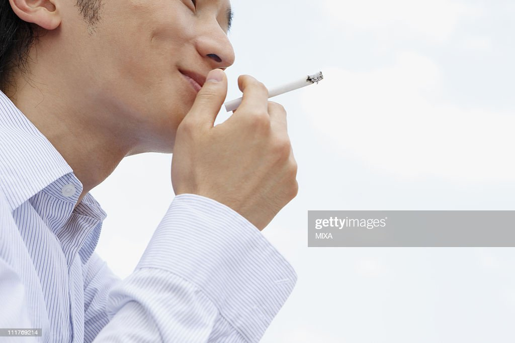 Mid Adult Man Smoking