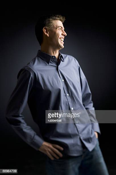Mid adult man standing with his hands on his hips