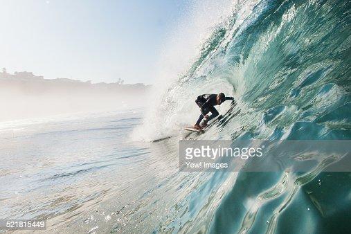 Mid adult man surfing rolling wave, Leucadia, California, USA