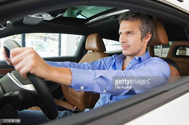 Mid adult man taking a test drive