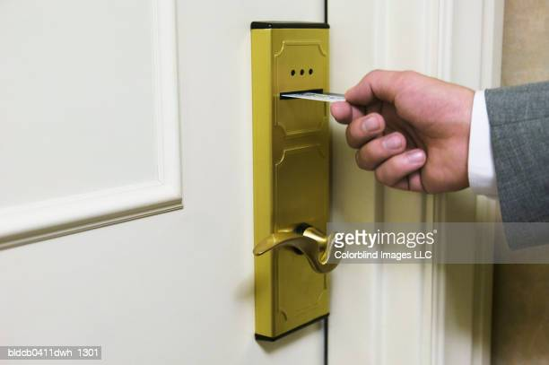 Mid adult man using a cardkey to unlock the door