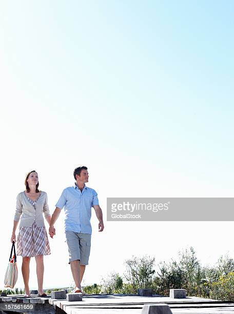 Mid adult man walking with his wife