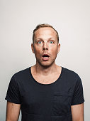 Mid adult man with expression feelings on his face studio shot series. disbelief and shock.