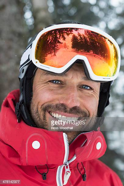 Mid adult man with ski goggles, smiling