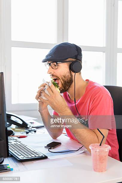 Mid adult man working in office