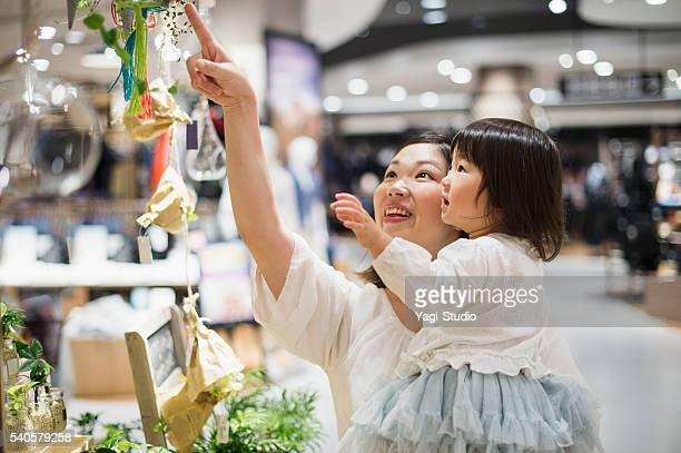Mid adult mother in a supermarket with family