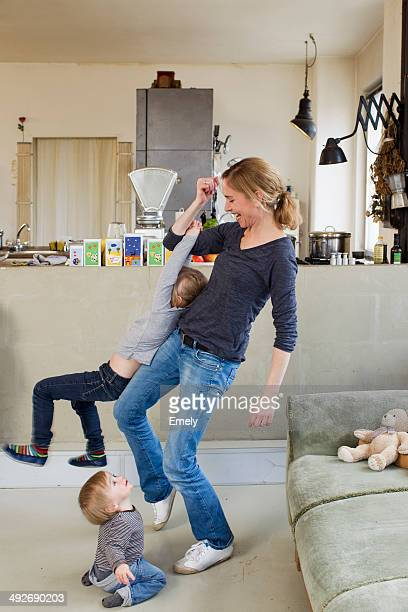 Mid adult mother playing with her two young daughters