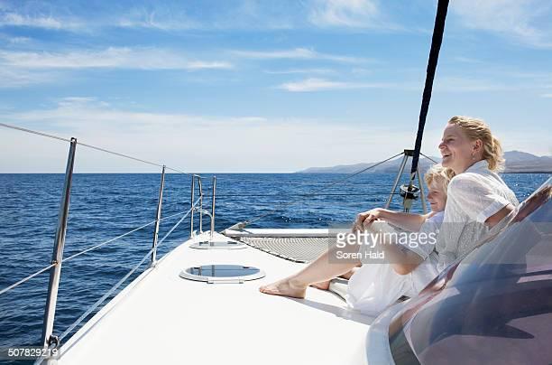 Mid adult mother son sailing on catamaran near Fuerteventura, Spain