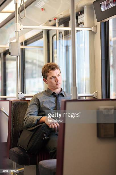 Mid adult office worker looking bored on train journey