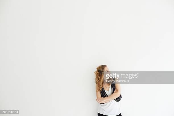 Mid adult woman arms crossed looking away