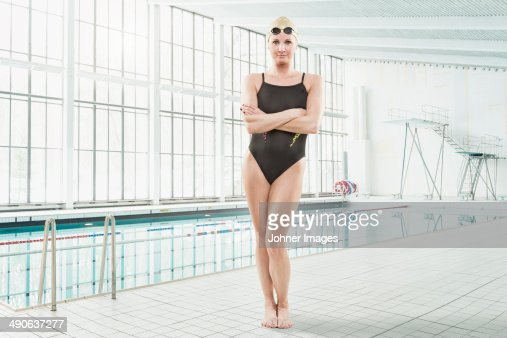 Mid adult woman at swimming pool