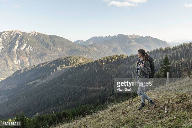 Mid adult woman backpacking in Achensee, Tyrol, Austria