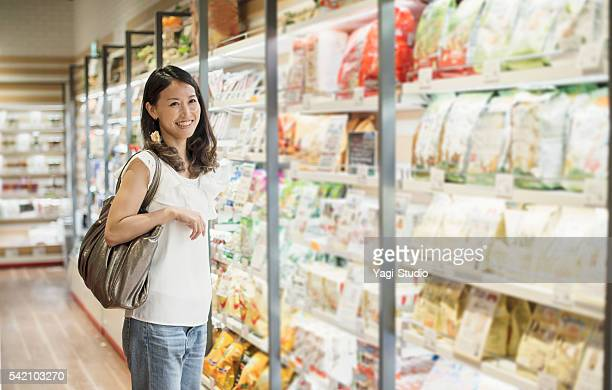 Mid adult woman buying grocery in supermarket