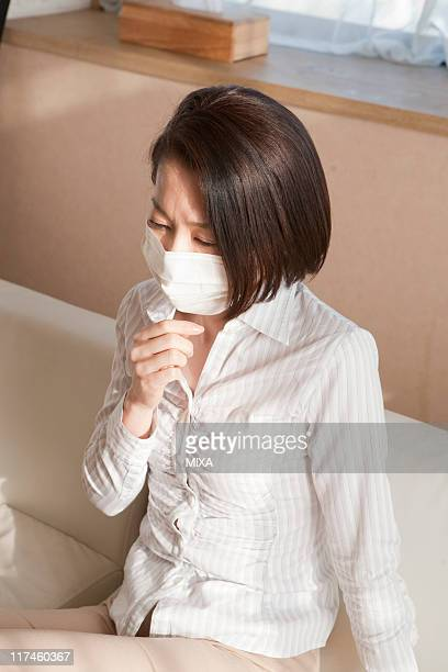 Mid adult woman coughing