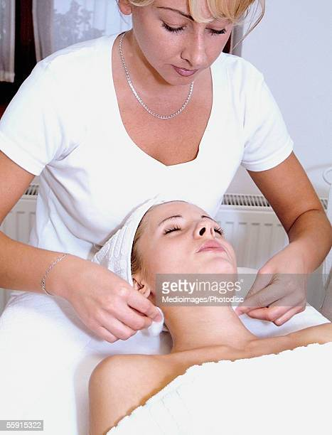 Mid adult woman getting a beauty treatment