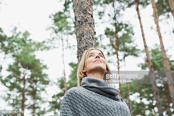Mid adult woman in forest, low angle