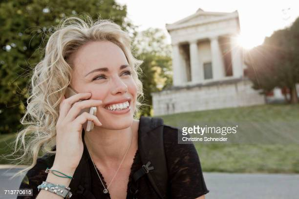 Mid adult woman in park making smartphone call