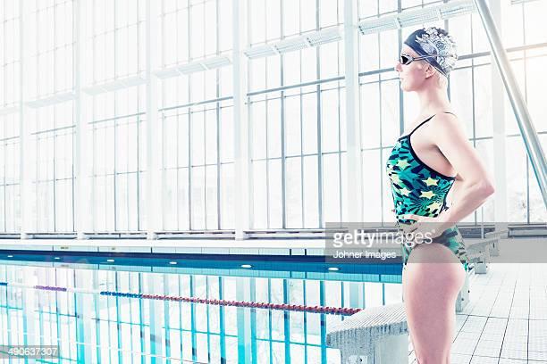 Mid adult woman in swimwear, side view