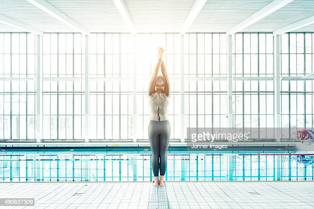 Mid adult woman in wetsuit at swimming pool