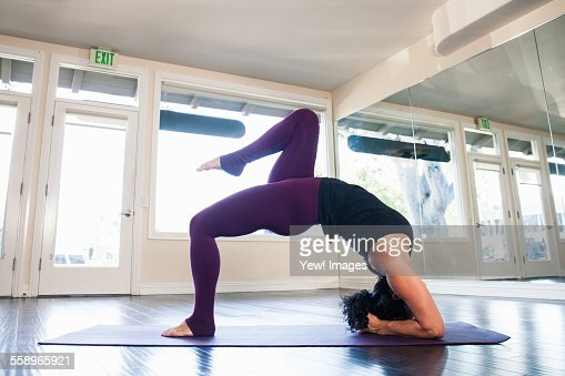 Mid adult woman in yoga position